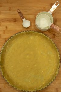 Low Carb Tart Crust Recipe is an easy to make crust perfect for your favorite tart and pie filling. Both KETO and gluten-free with no rolling pin needed!