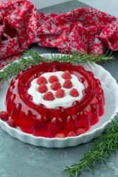 Try Low Carb Cream Filled Raspberry Jello for a delicious sugar free dessert or side dish. Perfect for your holiday table, picnics and parties!