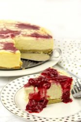keto raspberry cheesecake recipe, topped with raspberry puree. 8 ingredients are all you need to make this low carb dessert.