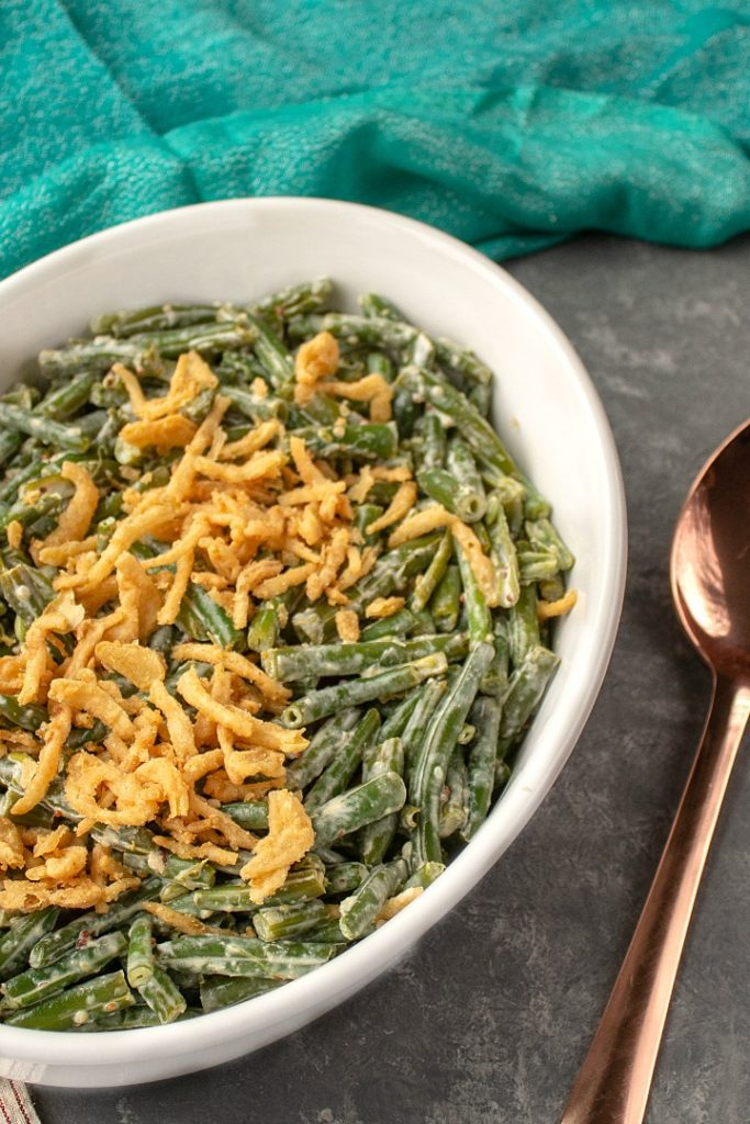 An easy, creamy low carb zesty green bean casserole that's loaded with tangy flavor!