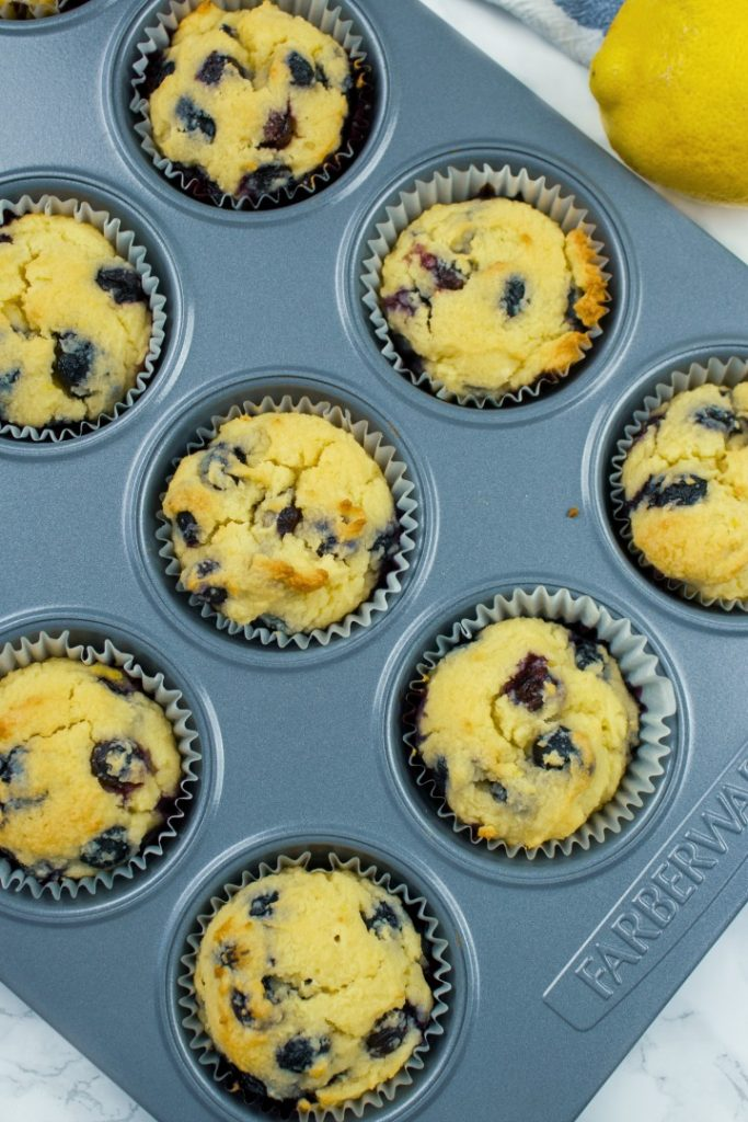 Pan full of Keto Lemon Blueberry Muffins