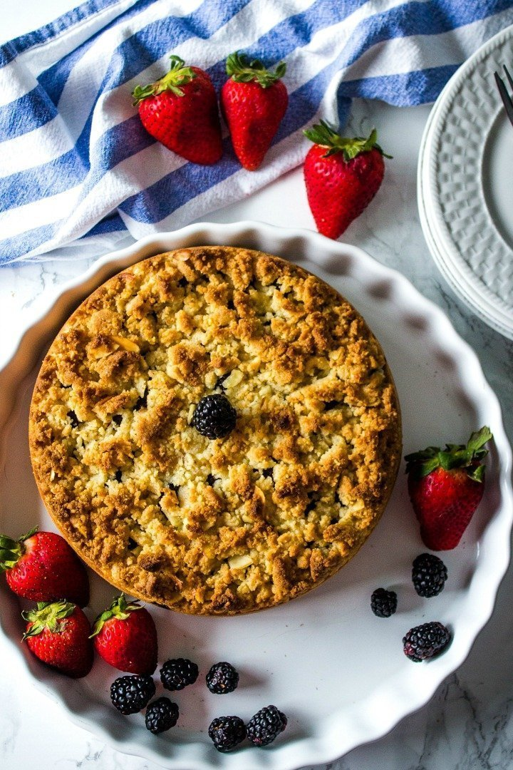 Full of berry and almond flavor with a crunchy streusel topping, this easy low carb cake has only per 4.5 net carbs per serving.  Ready for the oven in less than 10 minutes!