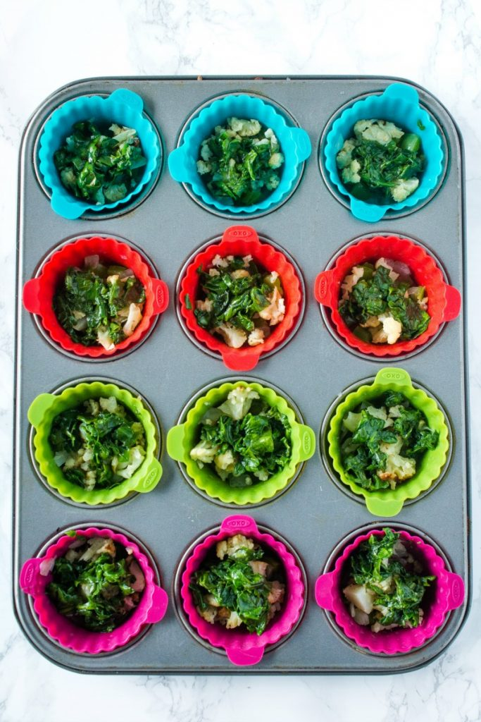 vegetables for egg muffins in colorful silicone cups