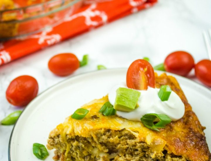 Easy Keto Taco Pie is total comfort food. Baked in the oven with ground beef, taco seasoning, eggs and cheese. #groundbeef #tacoseasoning #cheddarcheese #tacorecipes #holisticyum
