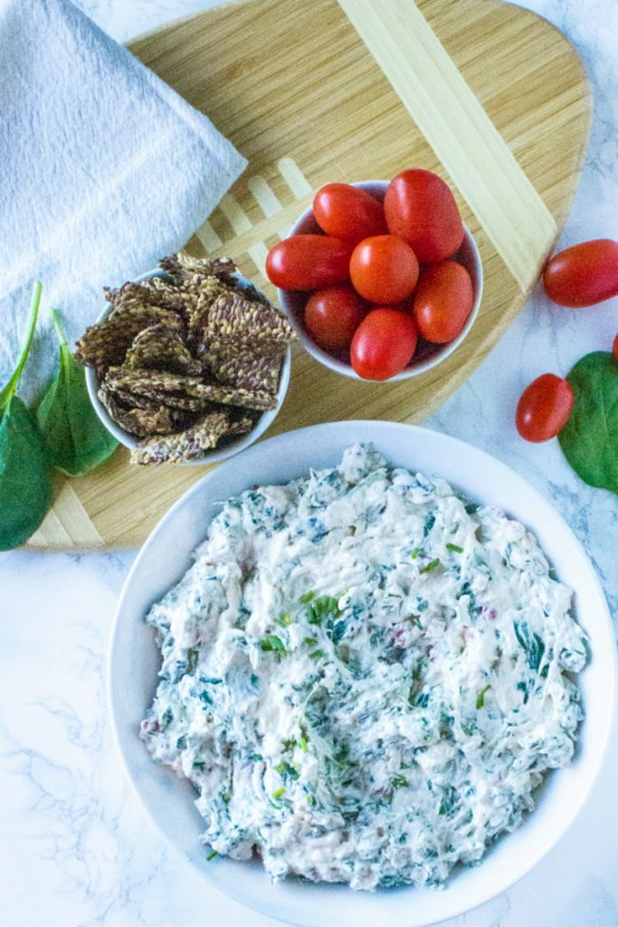 Made with spinach, red bell pepper and water chestnuts, this Low Carb Spinach Dip Recipe is both full of flavor and EASY!