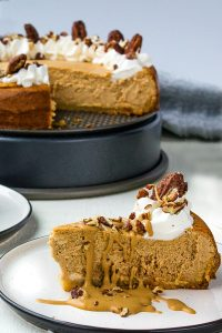 Easy Low Carb Pumpkin Spice Cheesecake is an almond flour crust topped with rich pumpkin spiced filling. It's a great make ahead dessert for a low carb Thanksgiving!