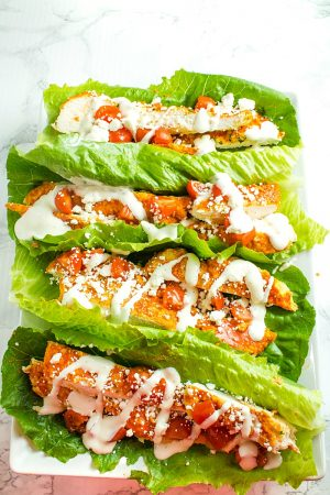 Keto Oven Buffalo Chicken Wraps made with chicken breasts, almond flour, buffalo sauce and tangy blue cheese toppings, they're are easy to make and packed with bold flavor and protein!