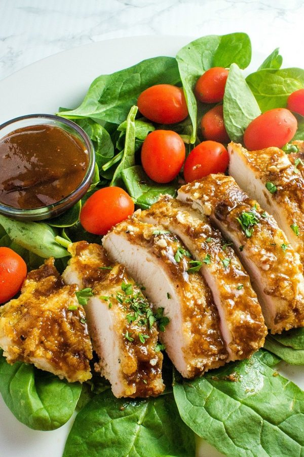 Keto Breaded Oven Barbecue Chicken are breaded and baked chicken breasts slathered with a rich barbecue sauce. Super easy to make and mouth watering delicious.
