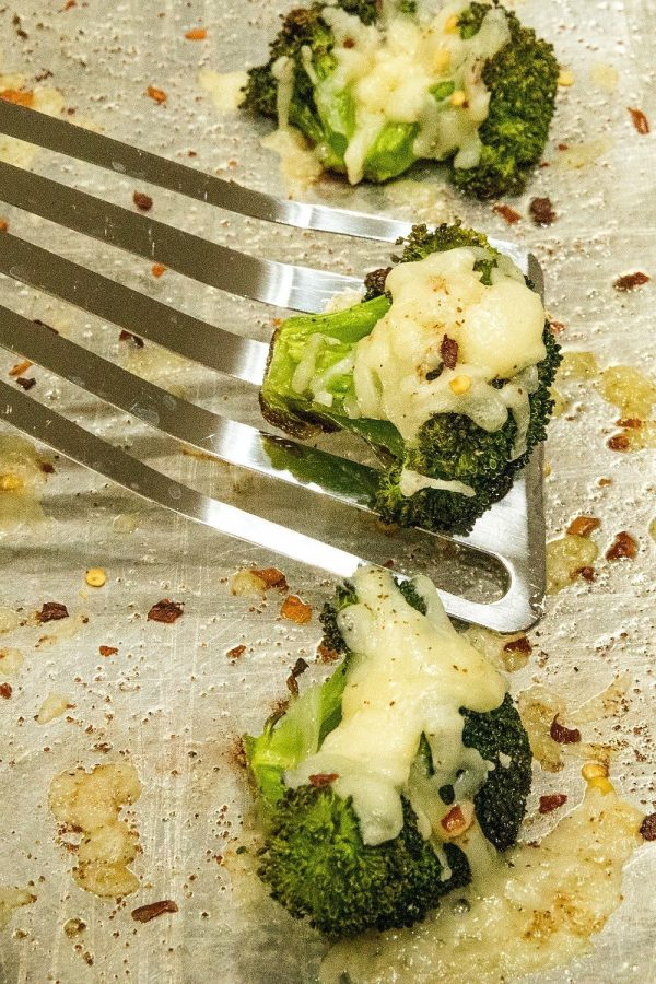 Roasted Broccoli Parmesan -Broccoli crowns tossed in olive oil and seasonings, roasted until tender then topped with garlic and parmesan cheese.