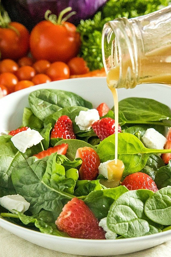 Fresh and healthy, this Keto Spinach Salad with Maple Dressing is a perfect side or healthy lunch that's ready in minutes with only 4 grams net carbs per serving. #holisticyum #spinachsalad #ketosaladdressing