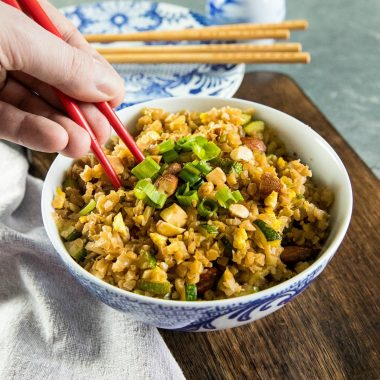 Easy Cauliflower Fried Rice with frozen riced cauliflower, zucchini, onions, garlic and egg. #holisticyum