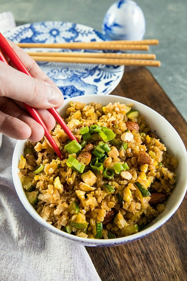 Easy Cauliflower Fried Rice with frozen riced cauliflower, zucchini, onions, garlic and egg. #holisticyum