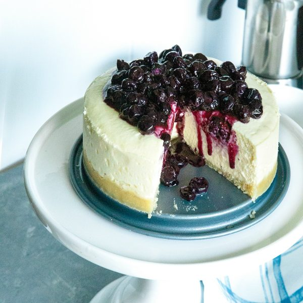 Instant Pot Keto Cheesecake with Blueberry Compote made from cream cheese, eggs and erythritol quick cooked on top of a tasty almond crust. #holisticyum