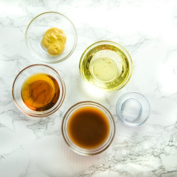 Maple salad dressing ingredients in small glass bowls