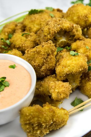 crispy florets, coated with pork rind breadcrumbs and baked to low carb perfection! Spicy, delicious and healthy too!