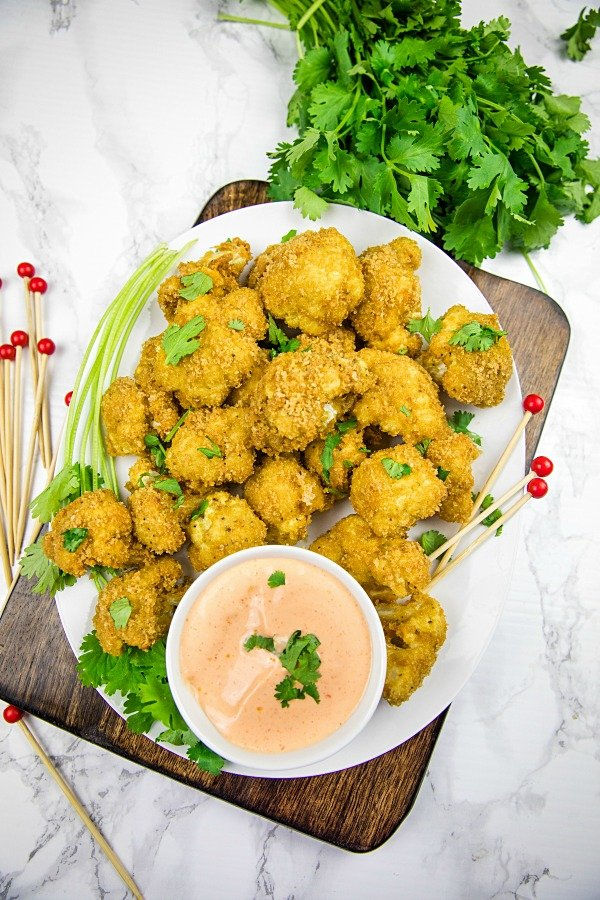 crispy florets, coated with pork rind breadcrumbs and baked to low carb perfection! Spicy, delicious and healthy too! #holisticyum